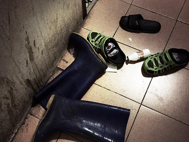 Shoes and litter lay scattered on the tiled floor.
