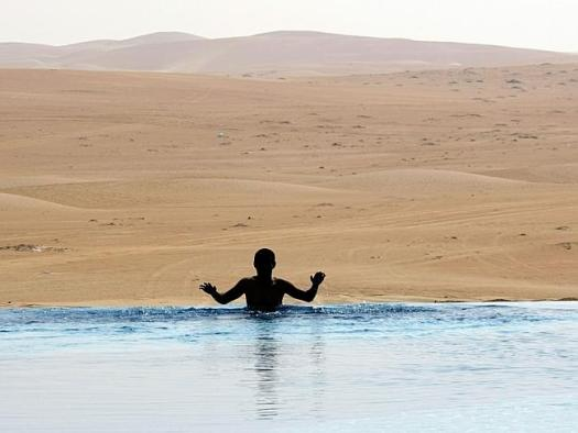Your hotel pool laps the expansive Liwa Desert. AFP PHOTO / KARIM SAHIB