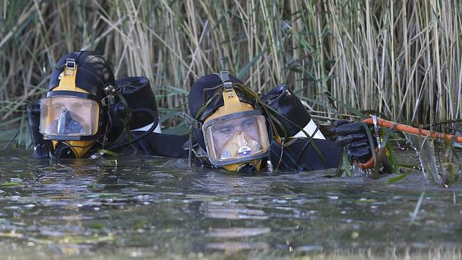Police divers search an irrigation channel for the body of teacher Stephanie Scott on the