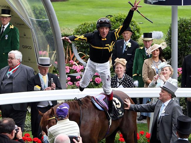 Jockey Frankie Dettori does his flying dismount, after winning the Diamond Jubilee Stakes