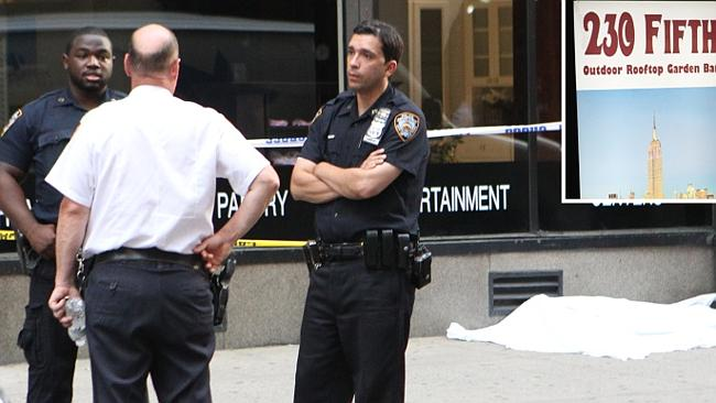 Police are the scene where a woman jumped 20 storeys to her death from swanky rooftop bar
