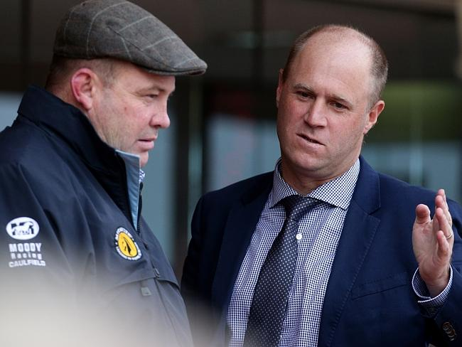 Trainers Peter Moody and Danny O'Brien in deep discussion at Caulfield racecourse on Satu