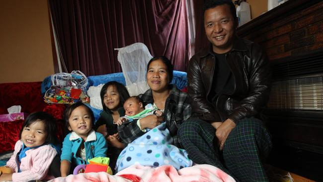 Burmese refugee and mother Tial, pictured with her family, has received a lot of help from St Kilda Mums. Picture: Glenn Daniels