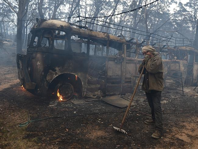 Resident Sean Butler stands in front of his 1958 bus after fighting a fire / Picture: AAP/Dean Lewins
