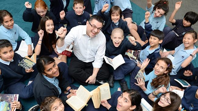 Manningham Cr Jim Grivokostopoulos, with Grade 5 and 6 students at Templestowe Heights Primary School earlier this year, has bee