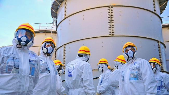Close eye ... International inspectors look at water storage tanks at the nuclear plant.