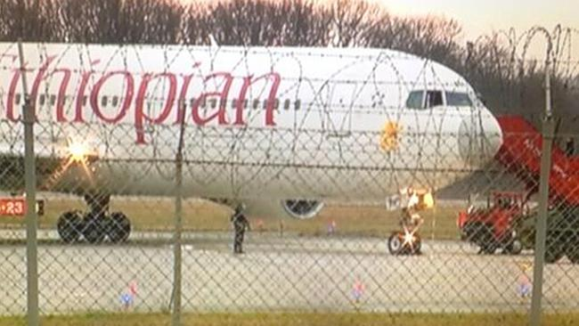 Alert ... police in body armour surround the plane at Geneva Airport.