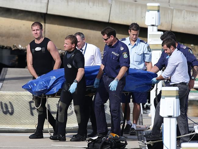 Police recover Gao's body wrapped in plastic and floating in water near Shelly Beach.