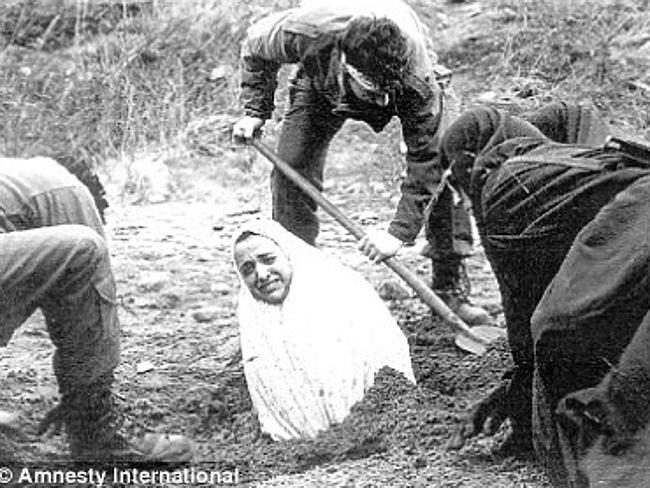 A 1990s Amnesty International image of a woman being buried before she was stoned to death in Iran. The punishment has been ...
