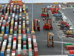 Containers and trucks line up at Port Botany. .