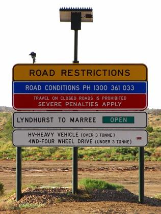 A road sign at Lyndhurst provides information on the condition of the road ahead.
