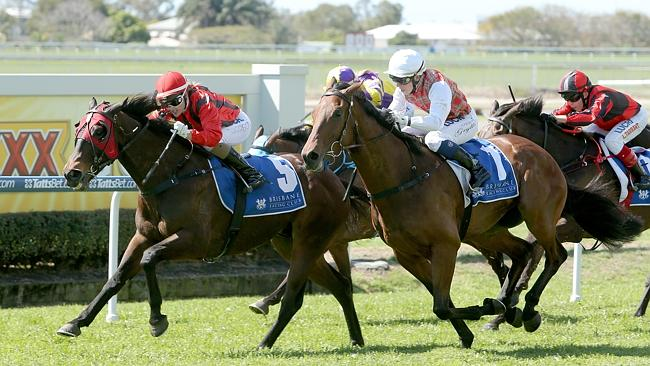 Tegan Harrison sits quietly on Uno Five as the pair hang on to score at Doomben. Picture: