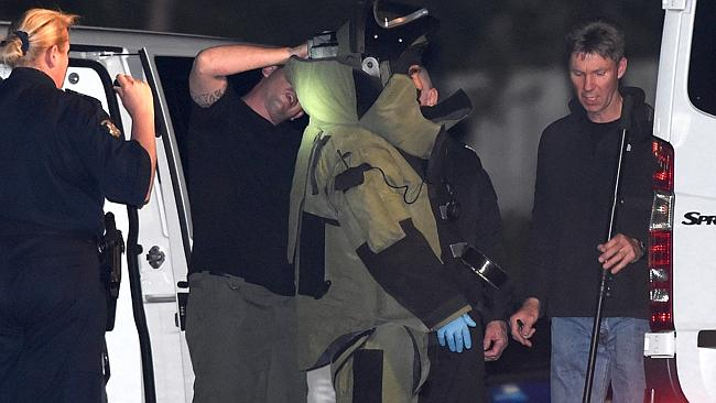 A bomb squad member is suited up before inspecting the police station. Picture: Mike Keat