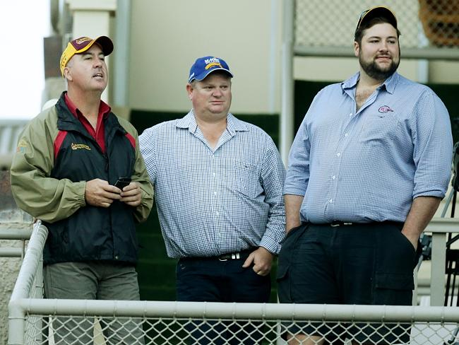 Troy Schmidt (middle) at Doomben trackwork this year with Steve Jones and Joe Heather. Pi