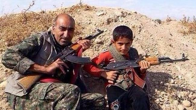 Members of a Kurdish family armed against ISIS, in the conflict which has spread from Ira