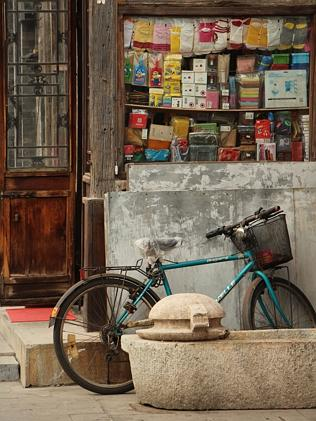 A bicycle parked outside a neighbourhood store in a Hutong near Houhai Lake. Picture: Sar