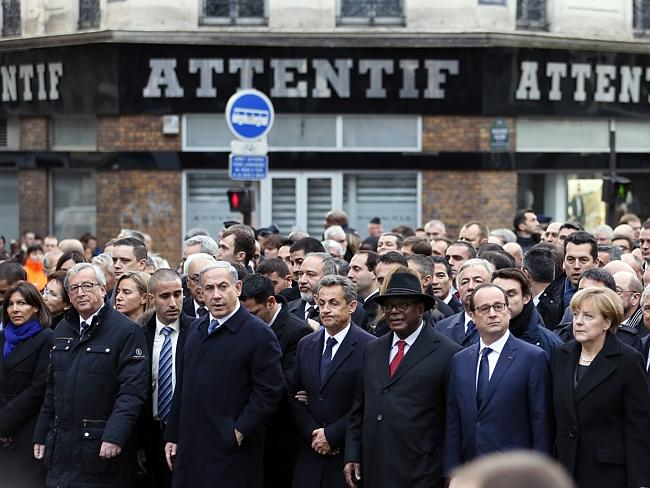 All together ... World leaders join the crowds in Paris. Picture: AFP