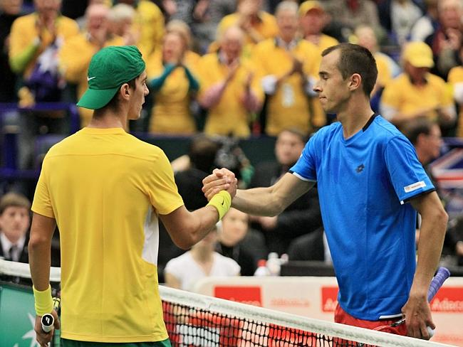 Thanasi Kokkinakis (L) shakes hands with Lukas Rosol after the first round tennis match o