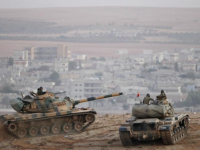 Turks and tanks ... Turkey's 'watch and wait' attitude was condemned by many western nati
