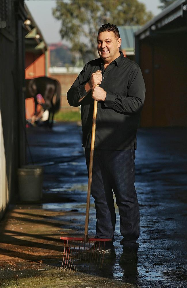 Tommy Hughes Jr at his Flemington stables. Picture: Colleen Petch