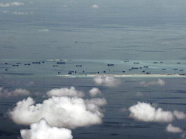 This areal photo taken through a glass window of a military plane shows China's alleged o