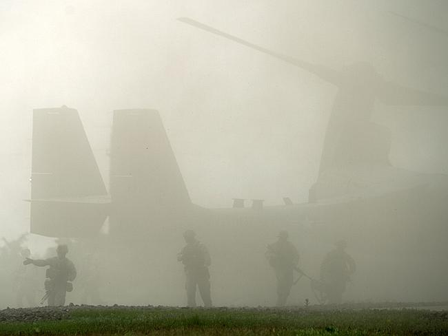 "Fog of words ... US Marines disembark from an MV-22B Osprey aircraft during the ""Platinum"