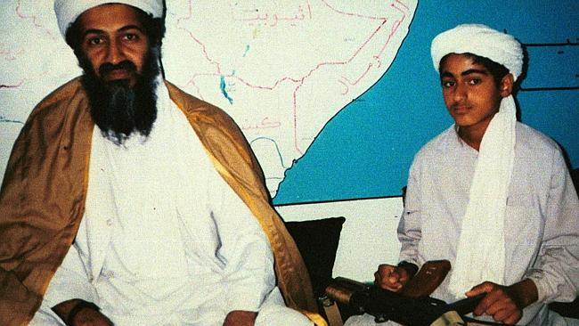 Osama bin Laden sits with his son in front of a map of the Arabian Gulf.