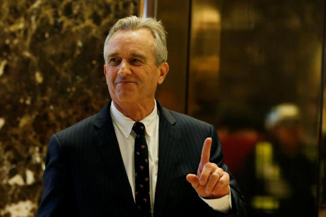 RFK Jr. gestures while entering the lobby of Trump Tower