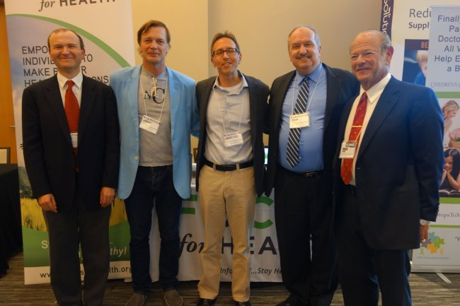 Mark (far right) and David Geier (far left) with other antivaccine luminaries