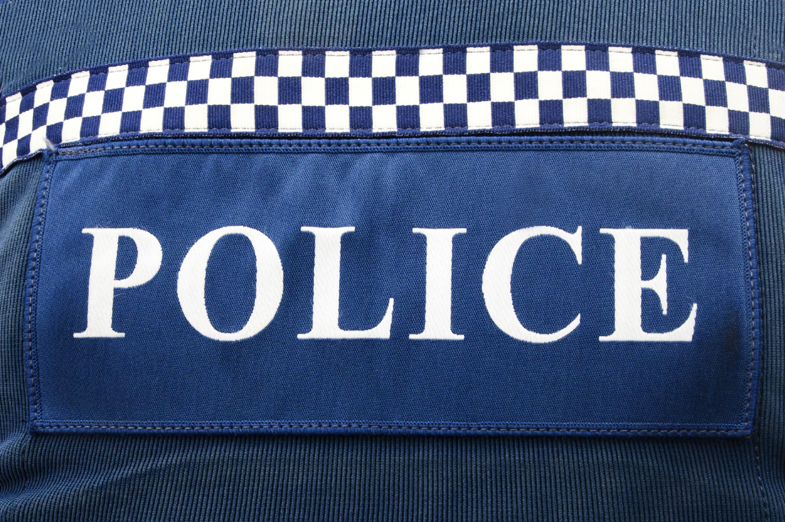 Close-up of NZ Police logo on police uniform.