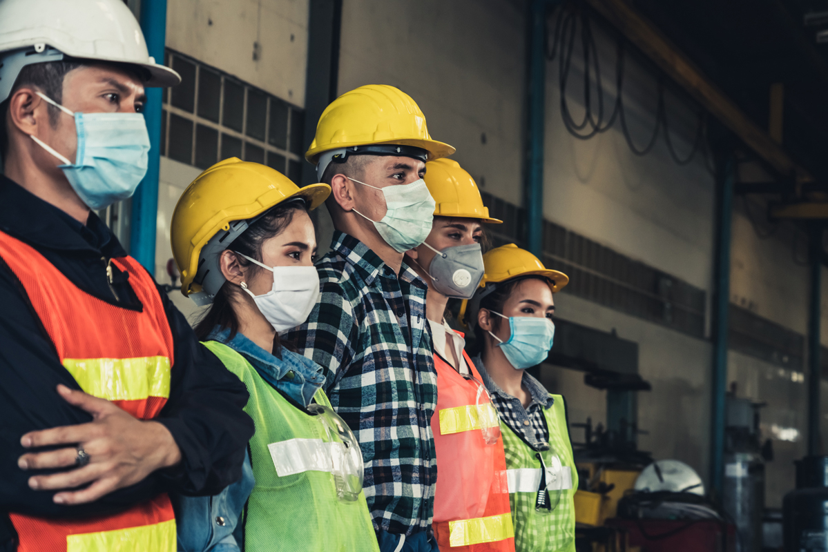 Factory workers with face masks
