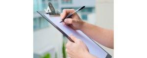 man-marking-health-inspection-checklist-on-clipboard