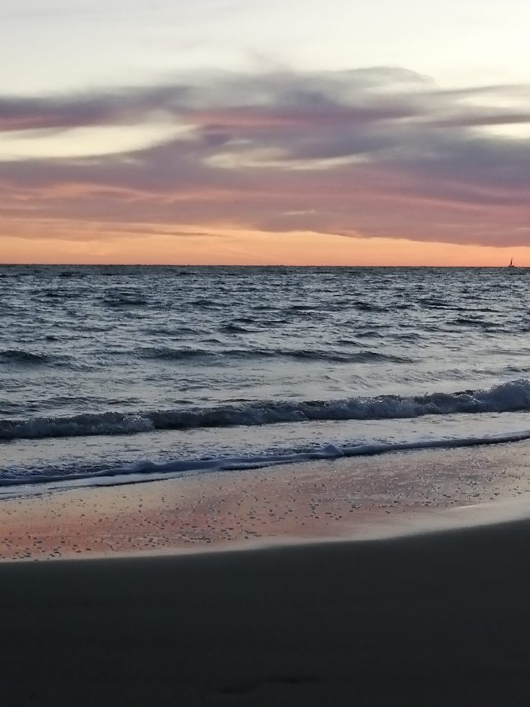 Sea beach and violet sky