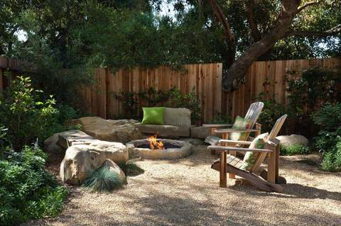 Stone Fire Pit With Adirondack Chairs