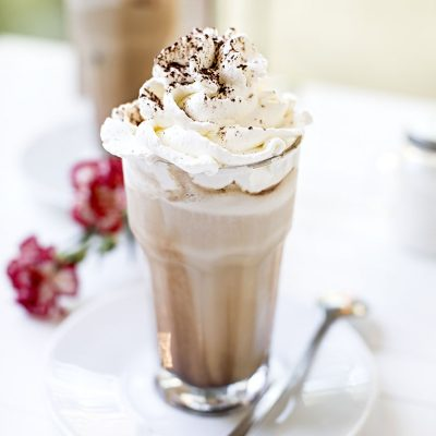 Iced Coffee latte with whipped cream and chocolate, Tall glass o