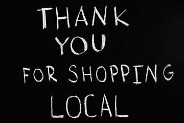 thank you for shopping local lettering text on black background