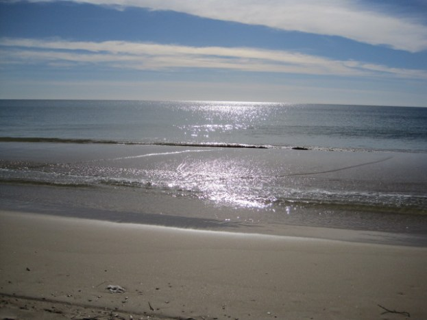 An empty beach with gently lapping tide