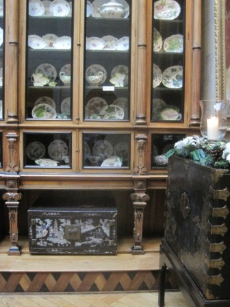 The mahogony cabinet, housing over 300 pieces of china, including Sevres