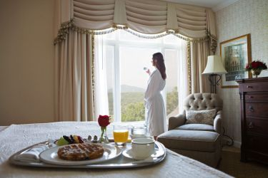 A woman enjoying breakfast recipes from the Biltmore chefs | Smoked salmon omelet