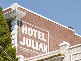 painted sign on brick for Hotel Julian