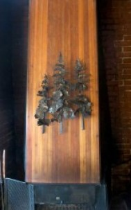Tree sculpture over the fireplace made by Verne Nelson