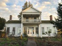 Sam Brown classical revival pioneer homestead with balcony over front portch