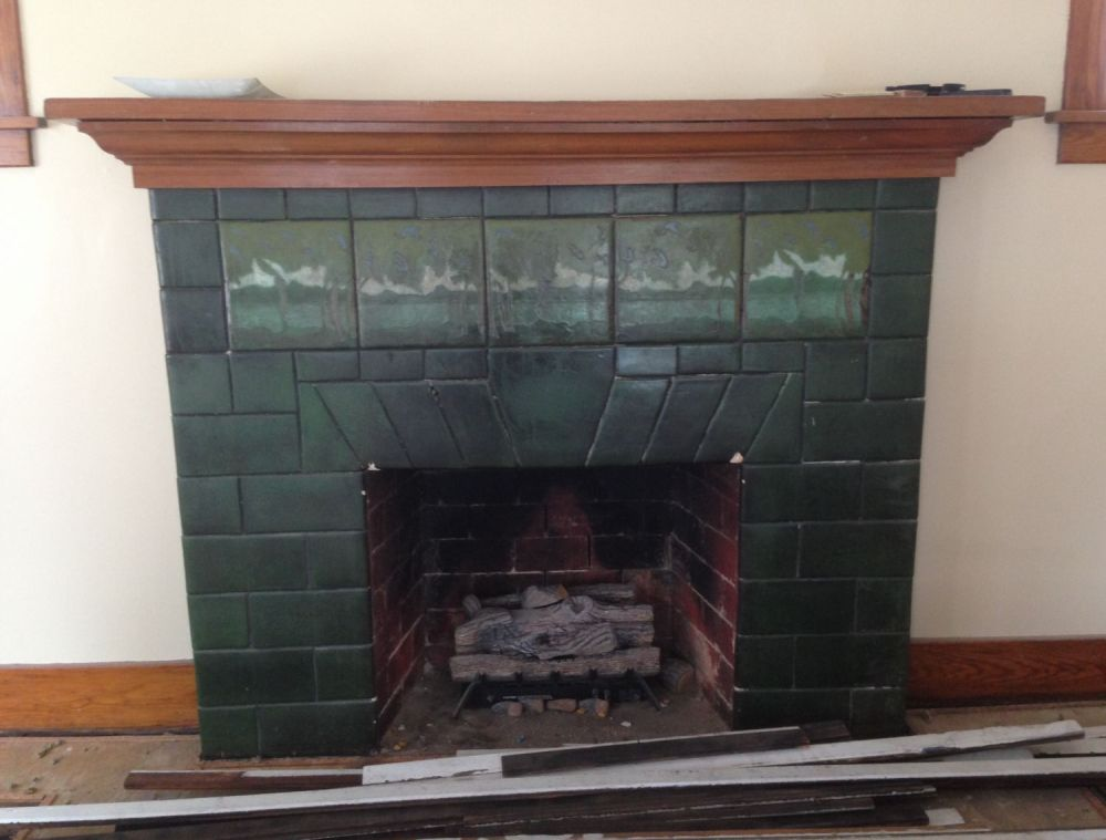 The living room has a stunning circa-1915 tiled fireplace. Who made the tiles?