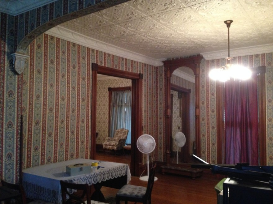 Looking from the foyer into the living room (parlor). Note how the cornice stops to accept the TALL mirror.