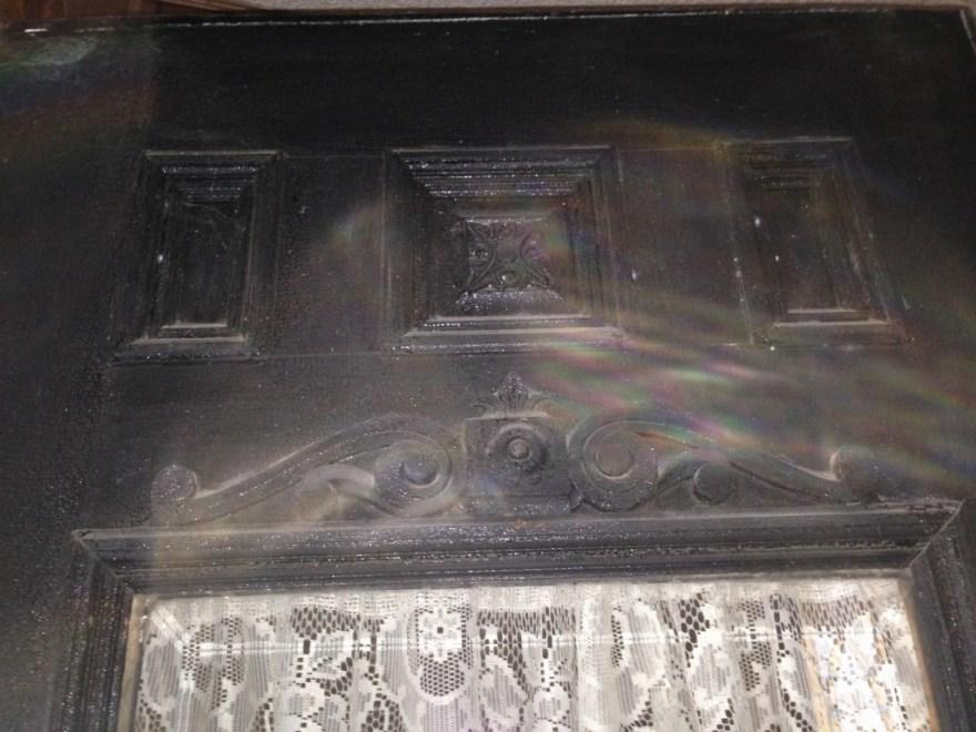 The upper part of the front door, now hidden behind a false panel.