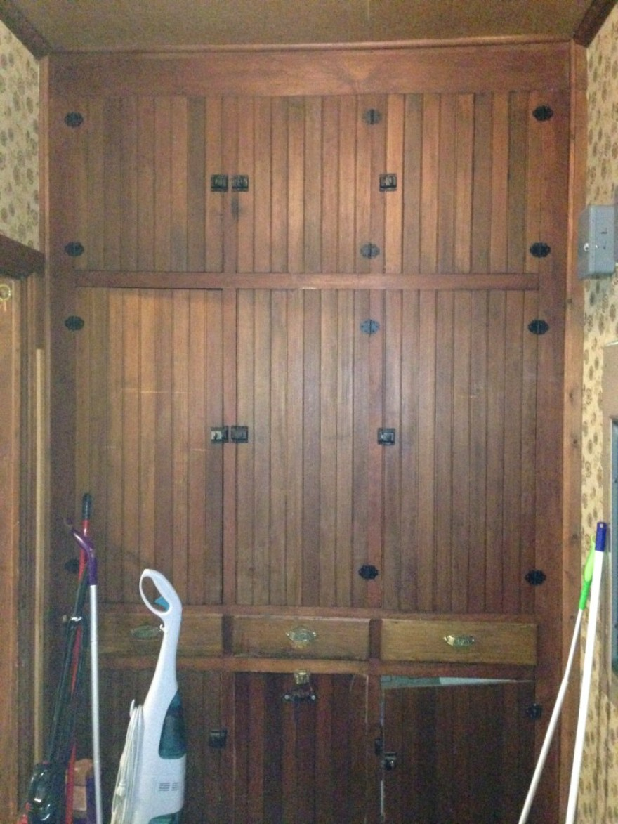Off the kitchen to the north is a pantry with nice original cabinets.