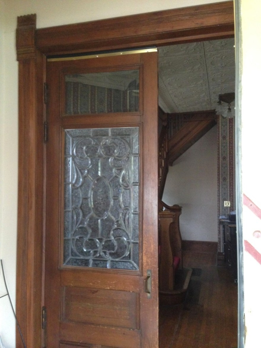 You come through the single front door, and into a vestibule. Double doors (with striking beveled glass leaded windows) open into the foyer.