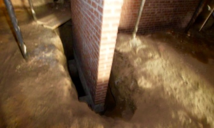 There has been extensive, and expensive, foundation work completed. This brick interior support (in the basement) rests on DEEP new footings.