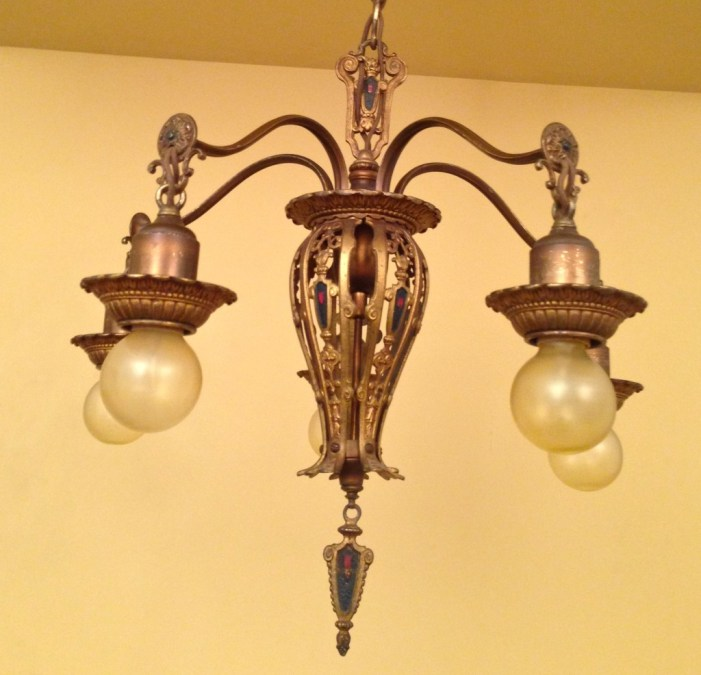 this gorgeous 1920s pair of Spanish-Revival chandeliers!