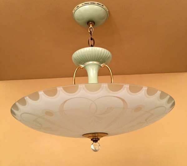 Today, we think of 1950s styling as being influenced by the Atomic age. But that is the late 1950s. The early 1950s are quite a different aesthetic, and this chandelier typifies the era at its very very very best.